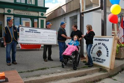 Knights of Columbus present donation to Bolton Family!