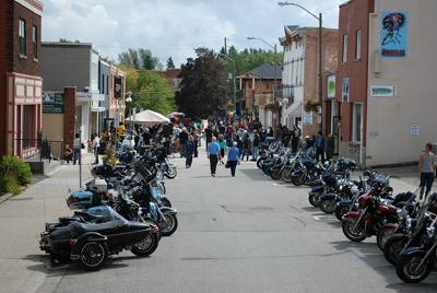 Motorcycles line Mill Street after event
