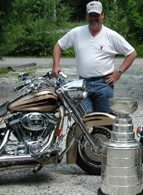 Pat Burns with the Stanley Cup and his Harley. His two passions.